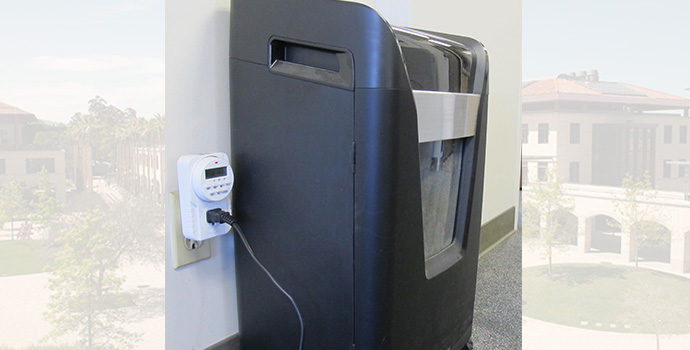 paper shredder plugged into equipment timer