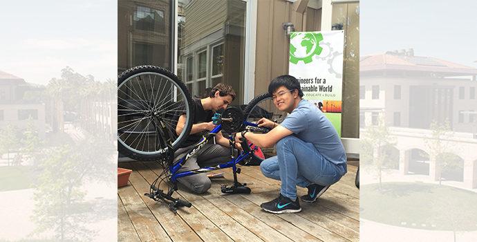 students repairing bikes